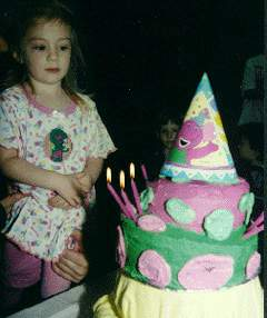Nikki and her Baby Bop/Barney cake atop a Baby Bop Yellow Blankie Pedestal